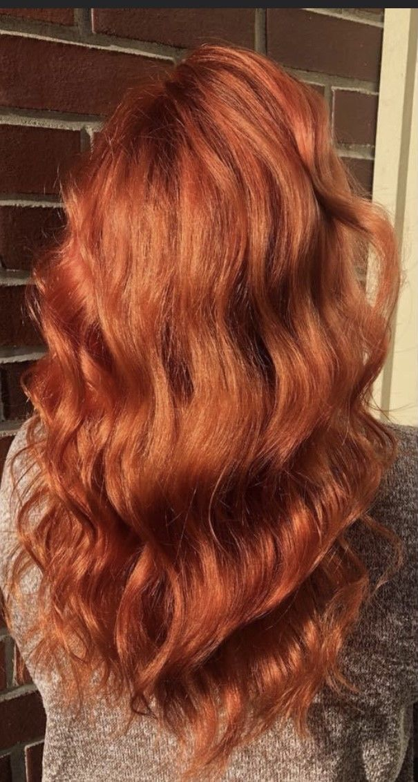 reddish brown hair with wave